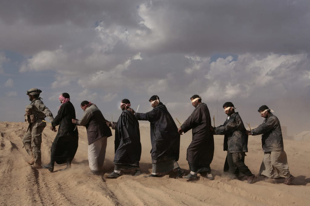Detainees held while they wait to be taken for questioning by helicopter. Northwest Iraq, 21 November 2005. Image © Sean Smith.
