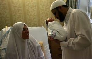 Sheikh Reda Shata, an imam, blesses a newborn child at a Brooklyn hospital Hospital. 2005 © James Estrin / The New York Times
