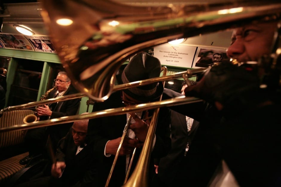 Members of the Duke Ellington Orchestra play on the A train in Manhattan. 2009 © James Estrin/The New York Times