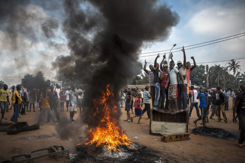 2nd Prize General News Stories: Demonstrators gather on a street in Bangui to call for the resignation of interim President Michel Djotodia following the murder of Judge Modeste Martineau Bria by members of Seleka. Bangui, Central African Republic © William Daniels, France, Panos Pictures for Time