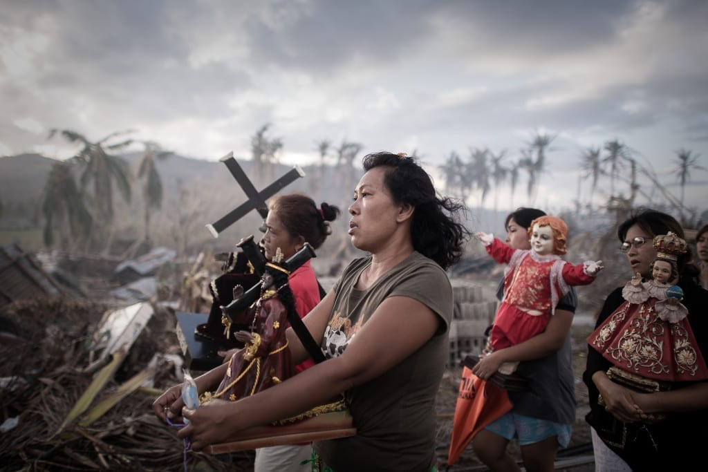 1st Prize Spot News Single: Survivors of typhoon Haiyan march during a religious procession in Tolosa, on the eastern island of Leyte. One of the strongest cyclones ever recorded, Haiyan left 8,000 people dead and missing and more than four million homeless after it hit the central Philippines © Phillipe Lopez, France, Agence France-Presse