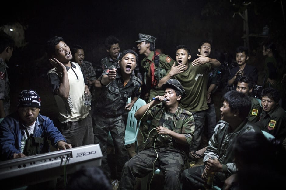 1st Prize Daily Life Single: Kachin Independence Army fighters are drinking and celebrating at a funeral of one of their commanders who died the day before. The city is under siege by the Burmese army © Julius Schrank, Germany, De Volkskrant