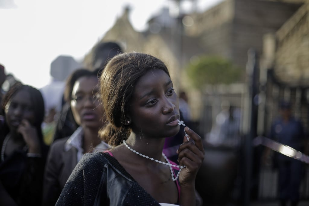 1st Prize People – Observed Portraits Single: A woman reacts in disappointment after access to see former South Africa President Nelson Mandela was closed on the third and final day of his casket lying in state, outside Union Buildings in Pretoria, South Africa © Markus Schreiber, Germany, The Associated Press