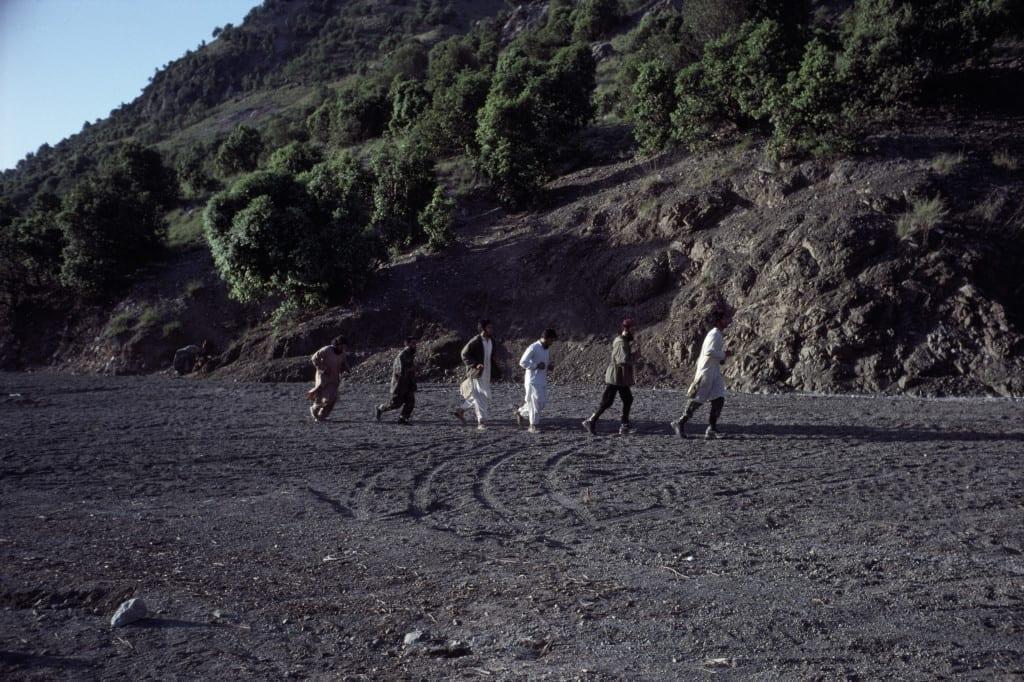May 1990: Arab Al Qaeda members and Afghan mujahideen jog at the Zhawar training camp in Khost province, Afghanistan © Robert Nickelsberg