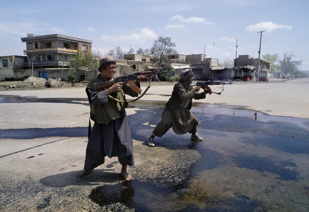 April 1992: Afghan Uzbek fighters under the control of Abdul Rashid Dostum fire on Hizb-i-Islami forces of Gulbuddin Hekmatyar in the southwest part of Kabul, during the mujahideen seizure of the city. The takeover of Kabul became a battle between mujahideen groups, divided along ethnic and geographic regions, attempting to seize control of key ministries © Robert Nickelsberg