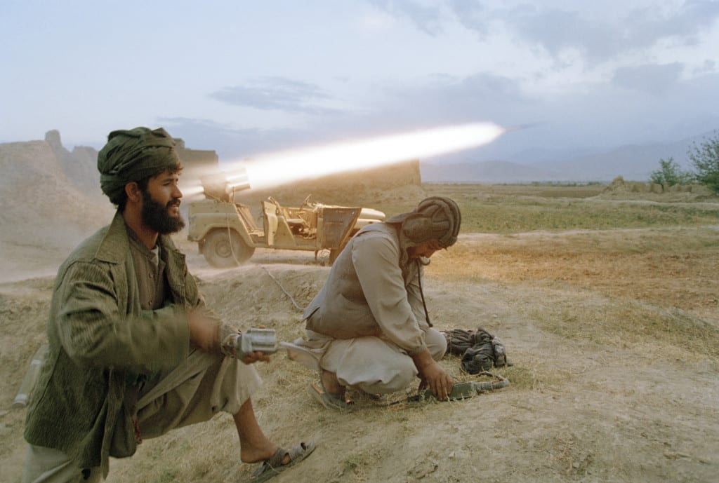 September 1996: Taliban soldiers fire a rocket at retreating forces of the Northern Alliance army north of Kabul. The capital fell to the Taliban on September 27, 1996. The Kabul government's defenses collapsed with little resistance to the Taliban advance © Robert Nickelsberg