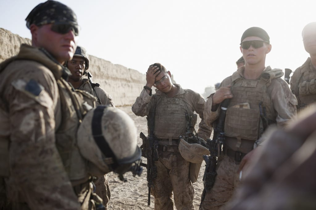 August 2009: US marines from the 2nd Light Armored Reconnaissance Battalion hold a briefing after a patrol in Khan Neshin, Helmand province © Robert Nickelsberg