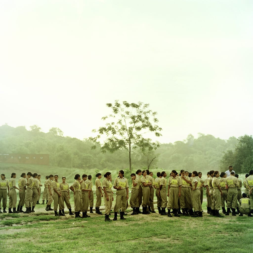 A company of 118 women of the Border Security Armed Force waiting for their training to begin before being deployed on the dangerous India - Pakistan Border areas. Khatka Camp, Punjab, India June 2009 © Poulomi Basu / VII Mentor Program