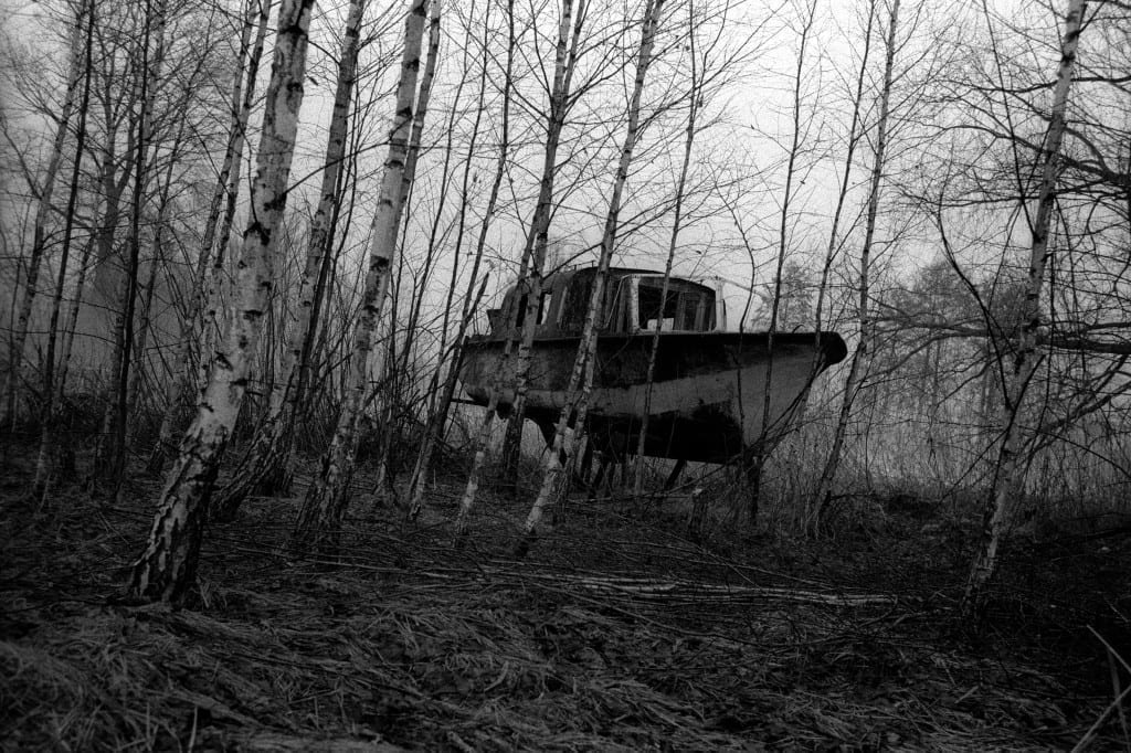 An old boat that has been left close to the port in the 30-km Exclusion Zone around the Chernobyl nuclear plant, in the village Teremzy, Ukraine, April 2010 © Arthur Bondar / VII Mentor Program