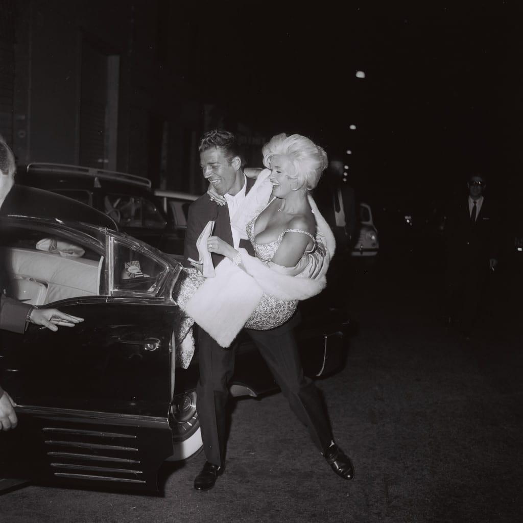 """Jane Mansfield and Mike Hargitay leaving """"Piccola Budapest"""", Rome, October 1962 © Marcello Geppetti , courtesy MGMC & Solares Fondazione delle Arti"""