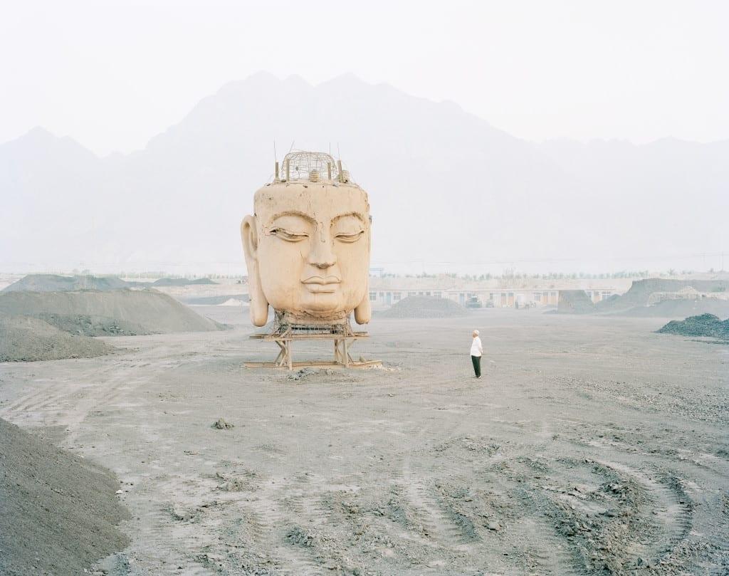 Buddha in Coal Yard, Ningxia Province, 2011 © Kechun Zhang