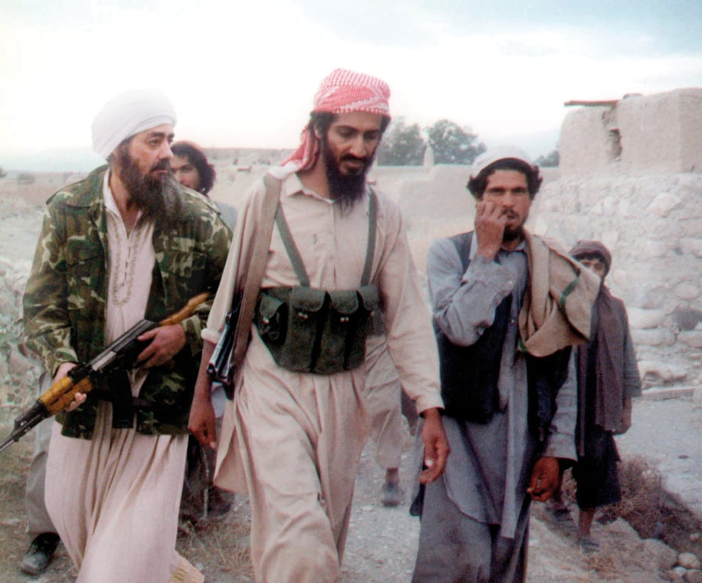 Osama and his faithful lieutenant Manbaa Mokfhi inspect an observation post in the Kurgan-Tyube border area, 2002, from the fictional series Deconstructing Osama (c) Joan Fontcuberta