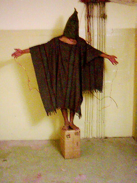 Sabrina Harman photographs scenes of tortures and abuses in which she took part, 04 November 2003, Abu Ghraib prison, Iraq. Source: AP