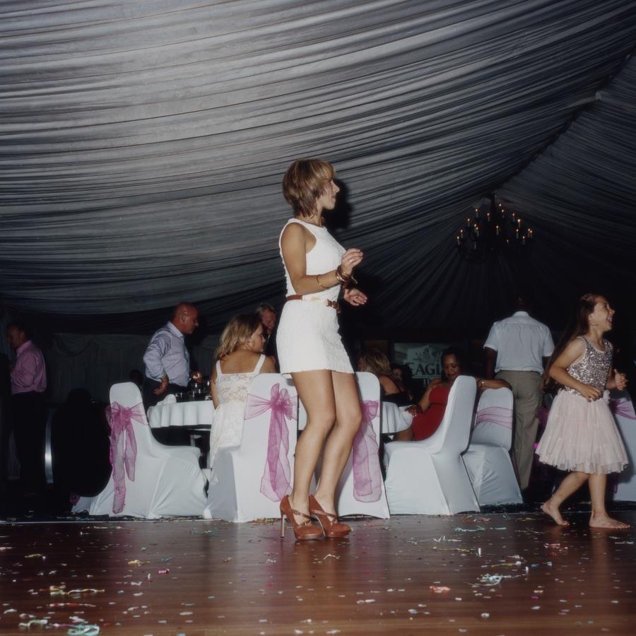 Woman dancing, Tara & Vito's wedding, Bedford, UK, 2013. Image © Lucy Levene
