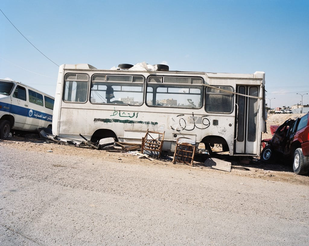 'Worried'; 'Activity' (graffiti on bus), Zarqa, Jordan, 2009. From the series, The Arabian Monument, 2007-2011. Image © Oliver Hartung