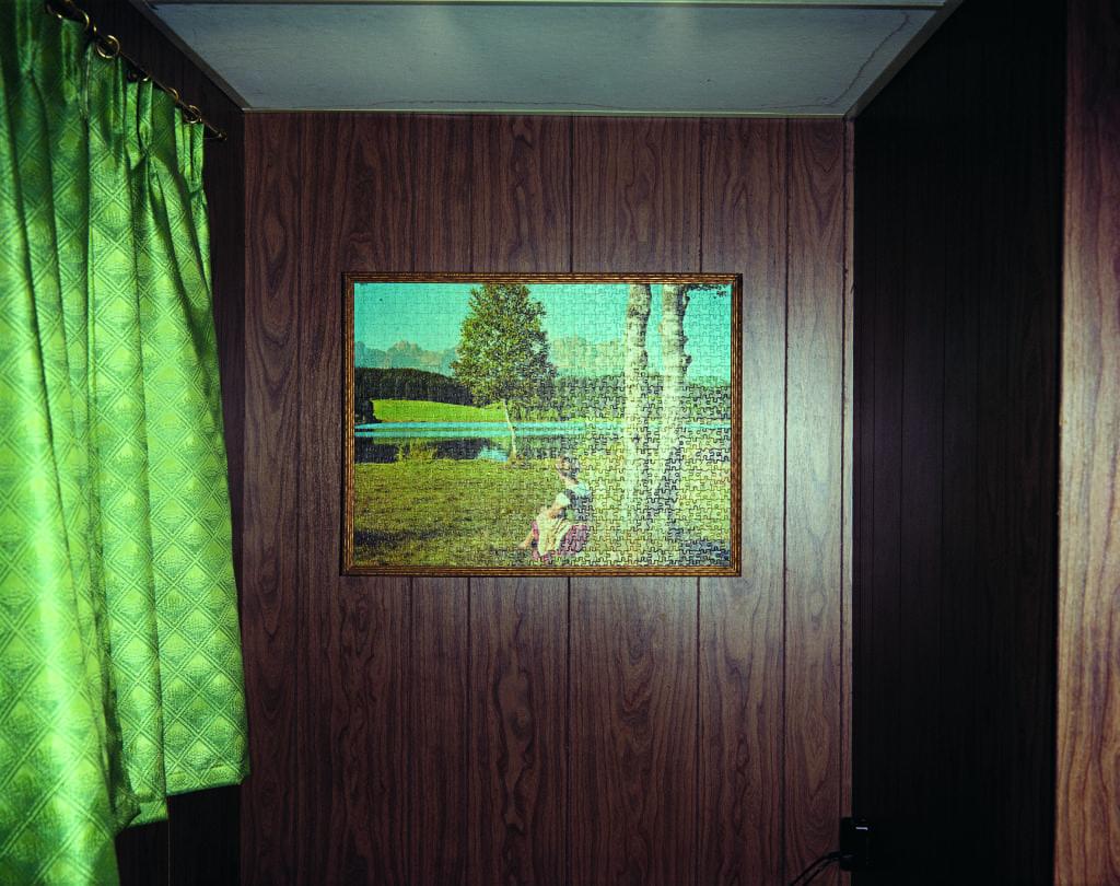 Jig-Saw Puzzle in Cabin #8, Beach Motel, Ashland, Wisconsin, July 9, 1973 © Stephen Shore
