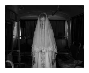 Rada, age 14, trying on a wedding dress. © Davide Monteleone
