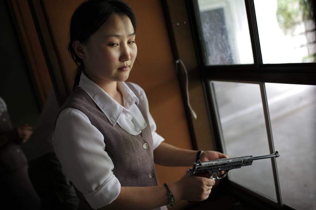 A North Korean woman loads a pistol for firing practice in Pyongyang, North Korea (DPRK) on 18 August, 2007. Image by Tomas van Houtryve/Getty Images Grant recipient 2013