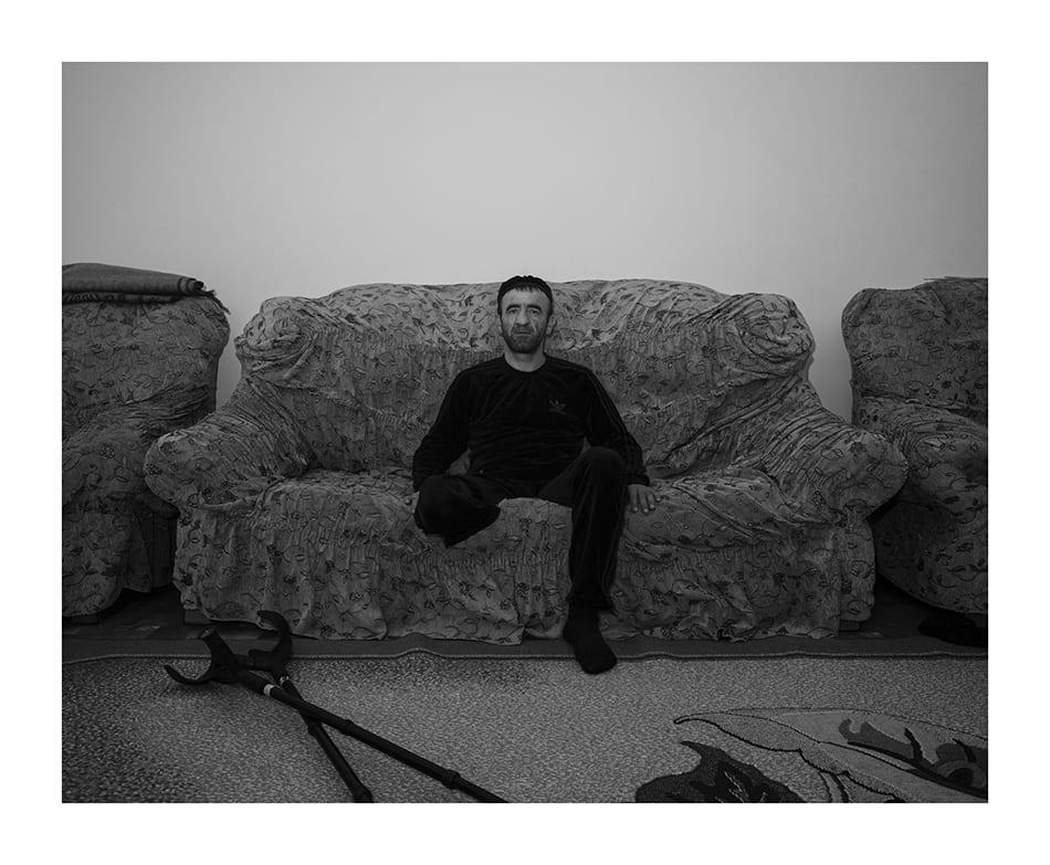 Portrait of Rustam Dokhtukaev inside his house. © Davide Monteleone