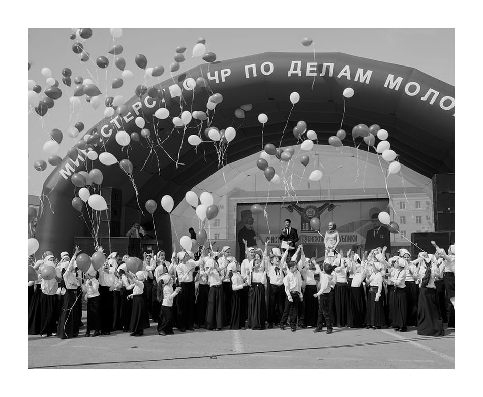 """Youths belonging to the """"Club Putin"""" and the """"Club Kadyrov"""" in the main square of the city to celebrate the 10th anniversary of the Constitution Day. © Davide Monteleone"""