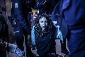 First Prize Spot News Category, Singles: Bulent Kilic, Turkey. A young girl is pictured after she was  wounded during clashes between riot police and prostestors, after the funeral of Berkin Elvan, the 15-year-old boy who died from injuries suffered during last year's anti-government protests on 12 March 2014 in Istanbul. Riot police fired tear gas and water cannon at protestors in the capital Ankara, while in Istbanbul, crowds shouting anti-government slogans lit a huge fire as they made their way to a cemetery for the burial of Berkin Elvan. © Bulent Kilic / Agence France-Presse