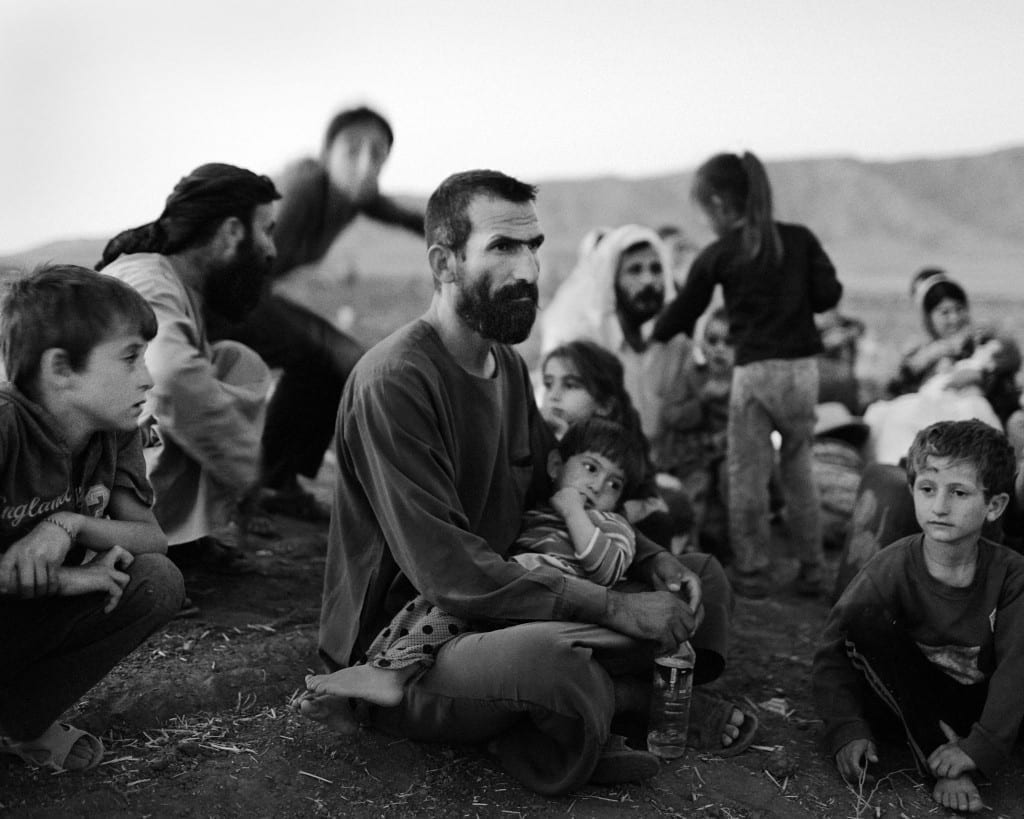 A Yazidi family who have just arrived at a refugee camp in Dohuk