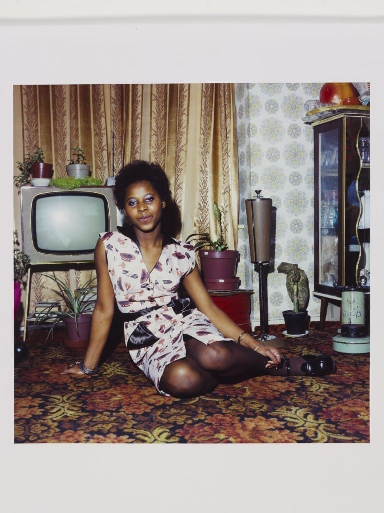 Untitled [Young woman seated on the floor at home in front of her television set, London 1972 © Neil Kenlock