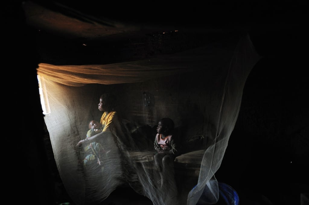 Kahindo, 20, sits in her home with her two children born out of rape in a village called Kayna in north Kivu, east Congo on April 12, 2008.
