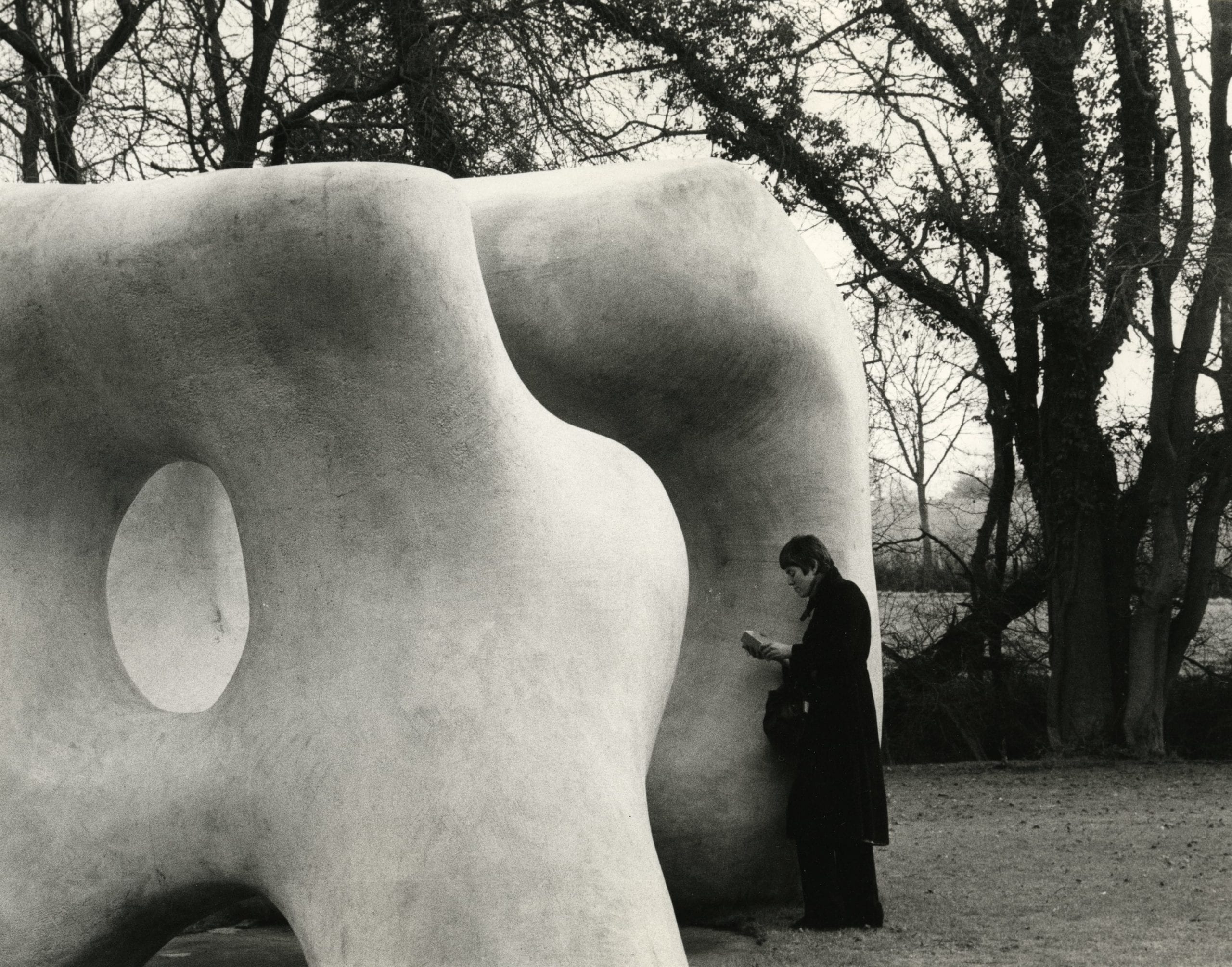 Andre Kertesz, Henry Moore Sculpture with Woman Reading, England, 1980. The Estate of Andre Kertesz 2015, Courtesy James Hyman Gallery, London