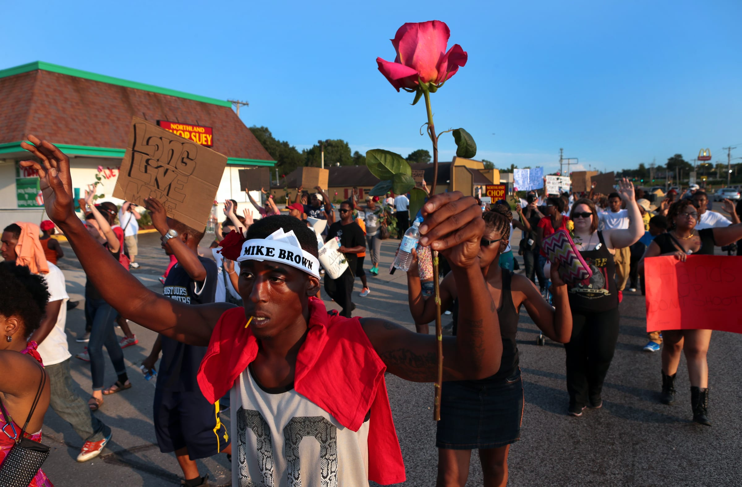 """Stevon Statom walks in a protest march on West Florissant Avenue on Tuesday, Aug. 19, 2014 in Ferguson.  Statom moved into an apartment at Canfield Green one week before Michael Brown was killed.  """"I'm trying to make a change in this world,"""" he said. Photo by Robert Cohen, rcohen@post-dispatch.com"""