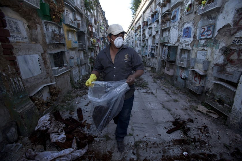 Every year workers in the largest public cemetery in Guatemala exhume the bodies of some 4,000 infants to deposit in a mass grave, which borders the main garbage dump in the capital city. Cemetery rules state that six years after a burial, relatives must pay 180 Quetzales, around US$24 dollars, to renew the burial plot for another four years. If there is no payment, cemetery workers exhume the bodies of the young children and put the skeleton in a mass grave. Almost none of the relatives pay the fees and over 4,000 bodies are exhumed annually.