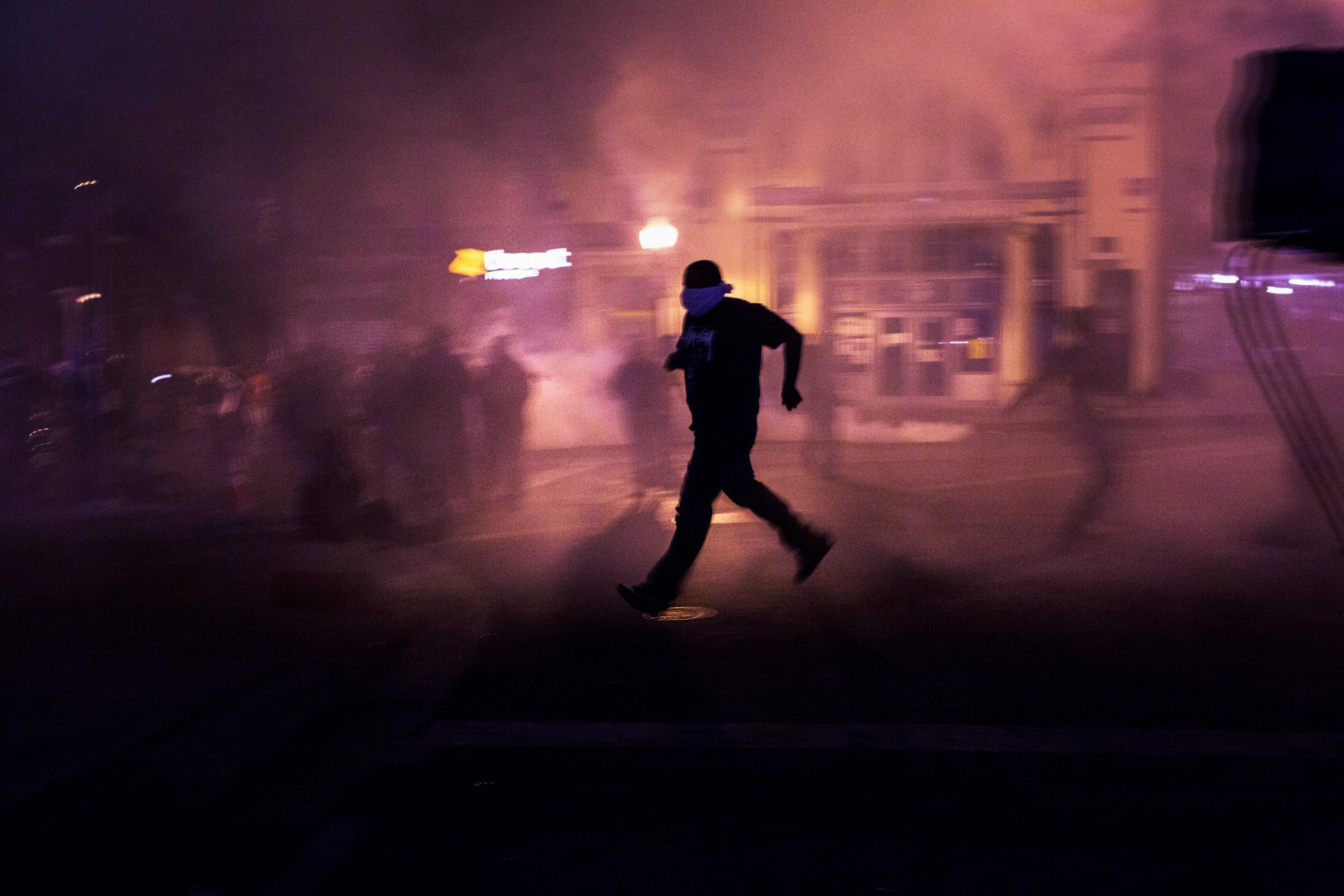 April 28th, 2015. Baltimore, Maryland. Police shoot tear gas to clear the street. Protesters, media, police and national guard converged near the corner of North and Pennsylvania Avenue during protests.
