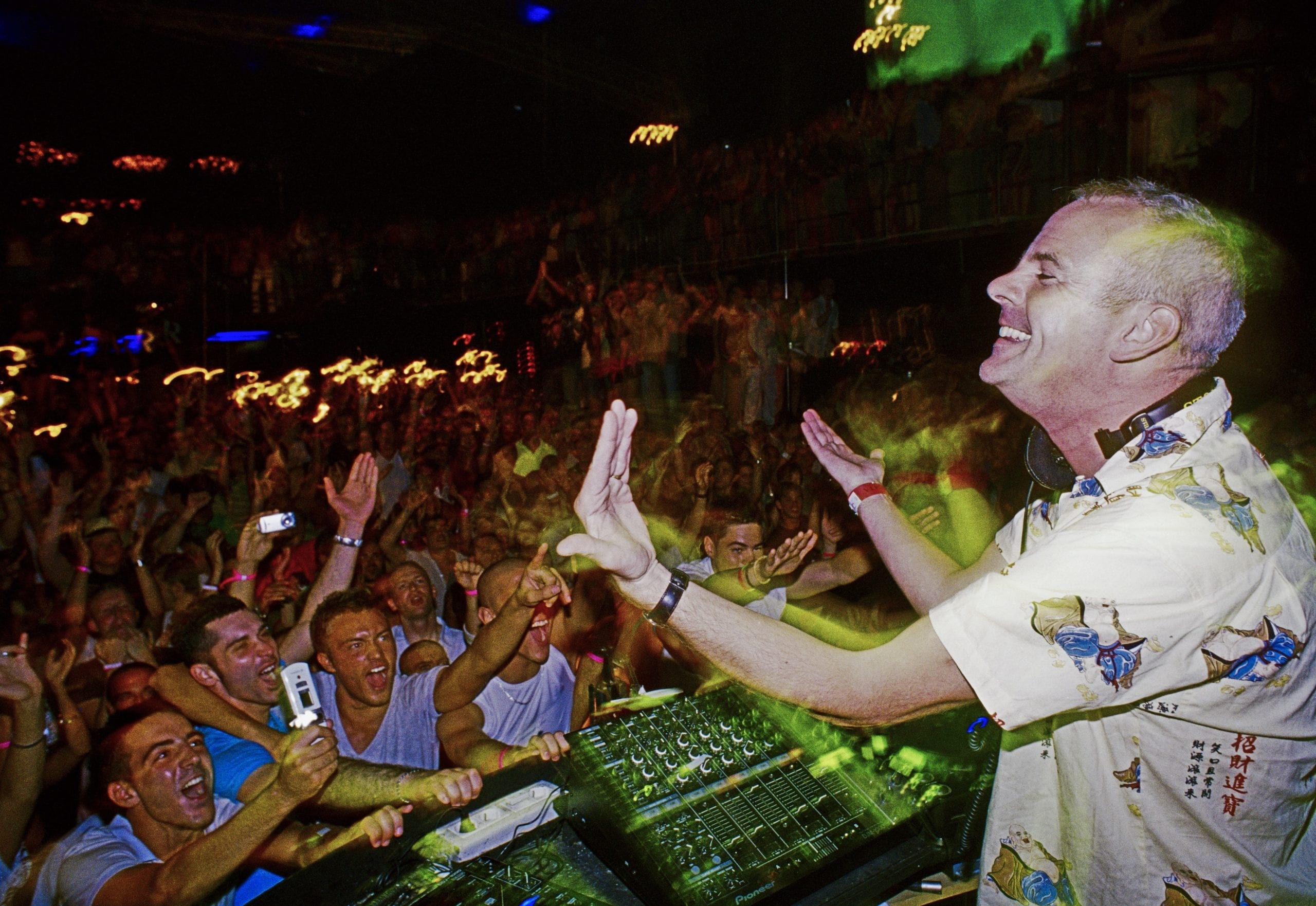 Norman Cook, aka Fatboy Slim, plays to a crowd of thousands at the world's biggest nightclub. Manumission, 2006 © Jocelyn Bain Hogg/VII