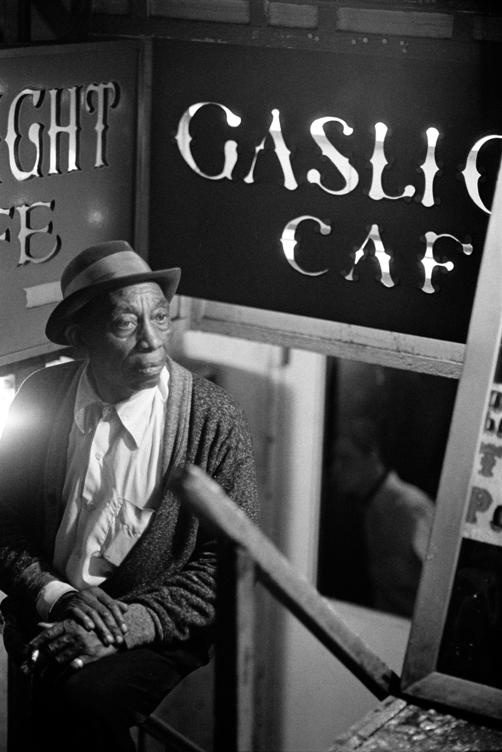 Mississippi John Hurt, outside The Gaslight Cafe, New York City, c. 1963
