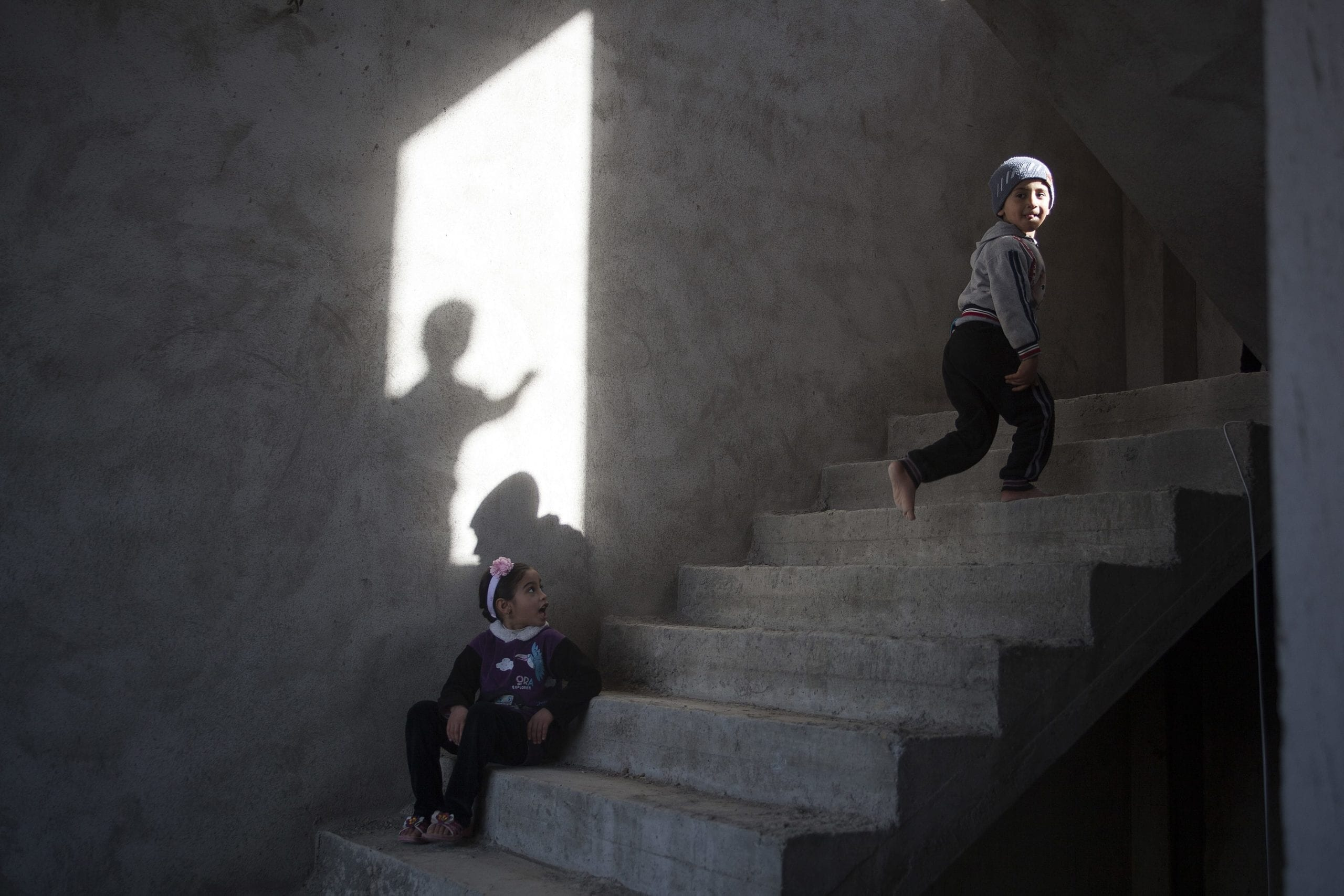 01/02/15. Sitak, Iraq. Children play on an unfinished staircase inside the building where they have been living with their families since August 2014, when they escaped from Sinjar.