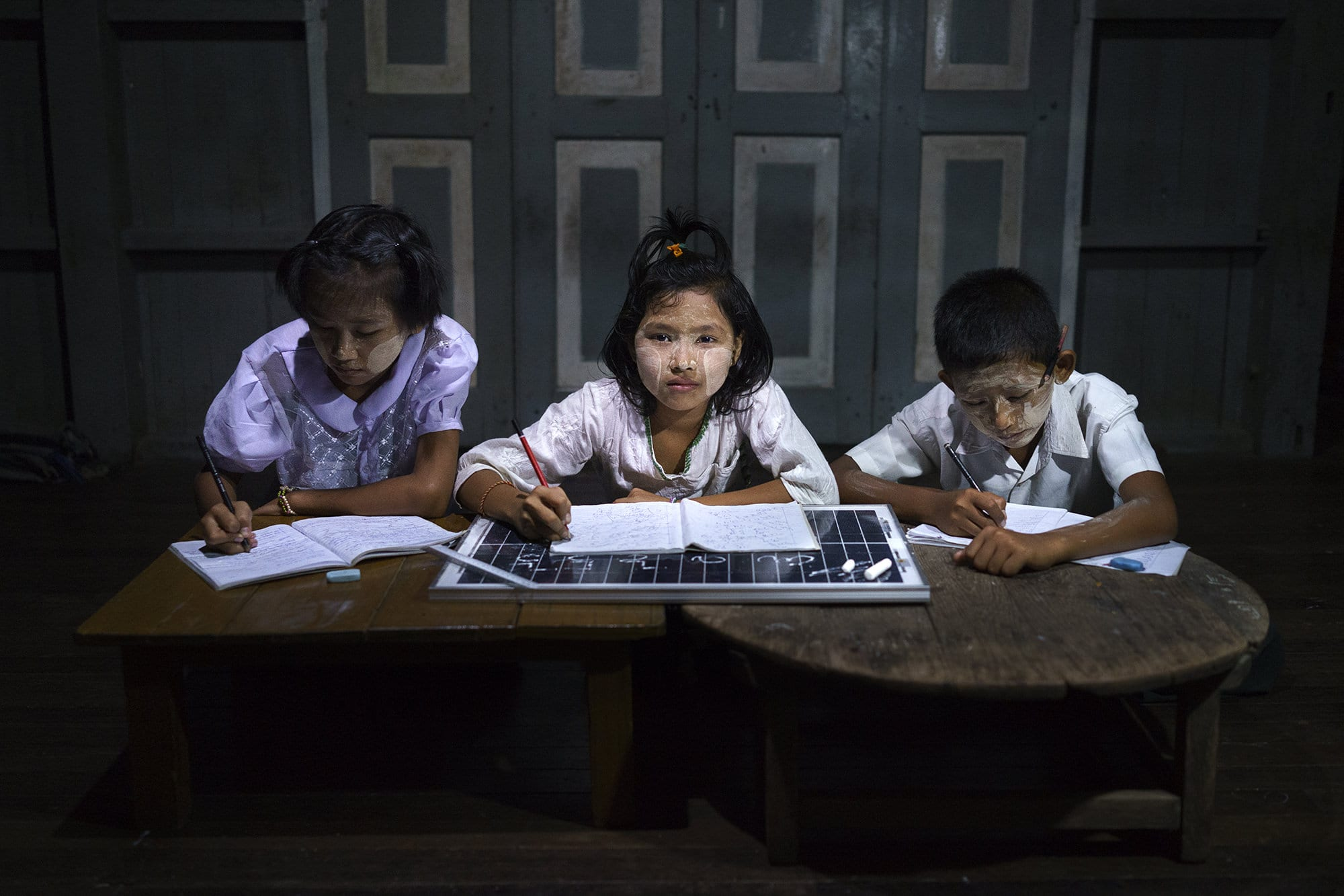 Grade 11 students do their homework in a solar-powered after-school community centre.