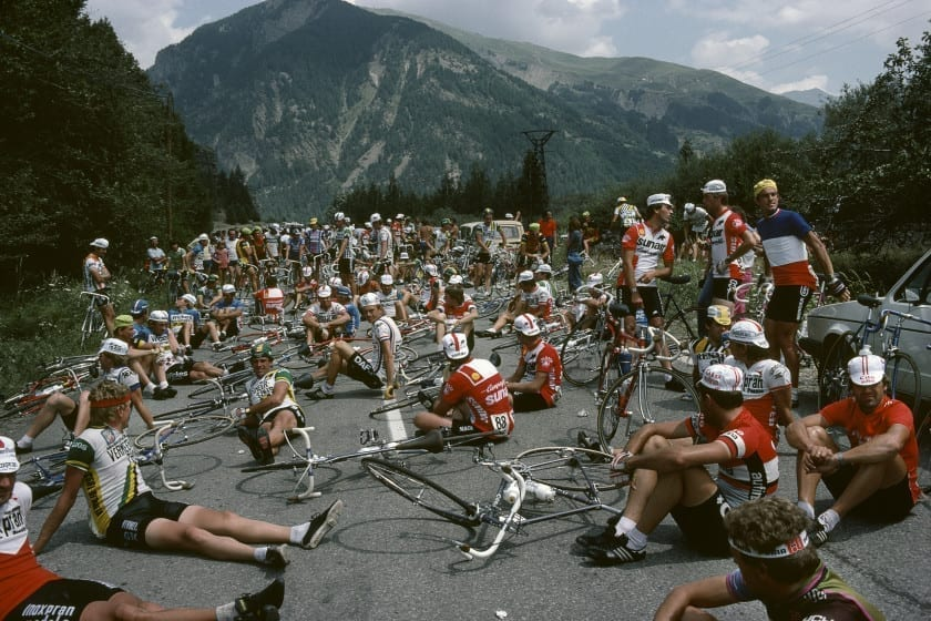 Tour de France 1982. Riders relax whilst the Tour organisers negotiate with farmers on stage 16 to remove their tractors from the road. Farmers are prostesting against  certain Common Market price fixing of agr. goods. France. 1982.