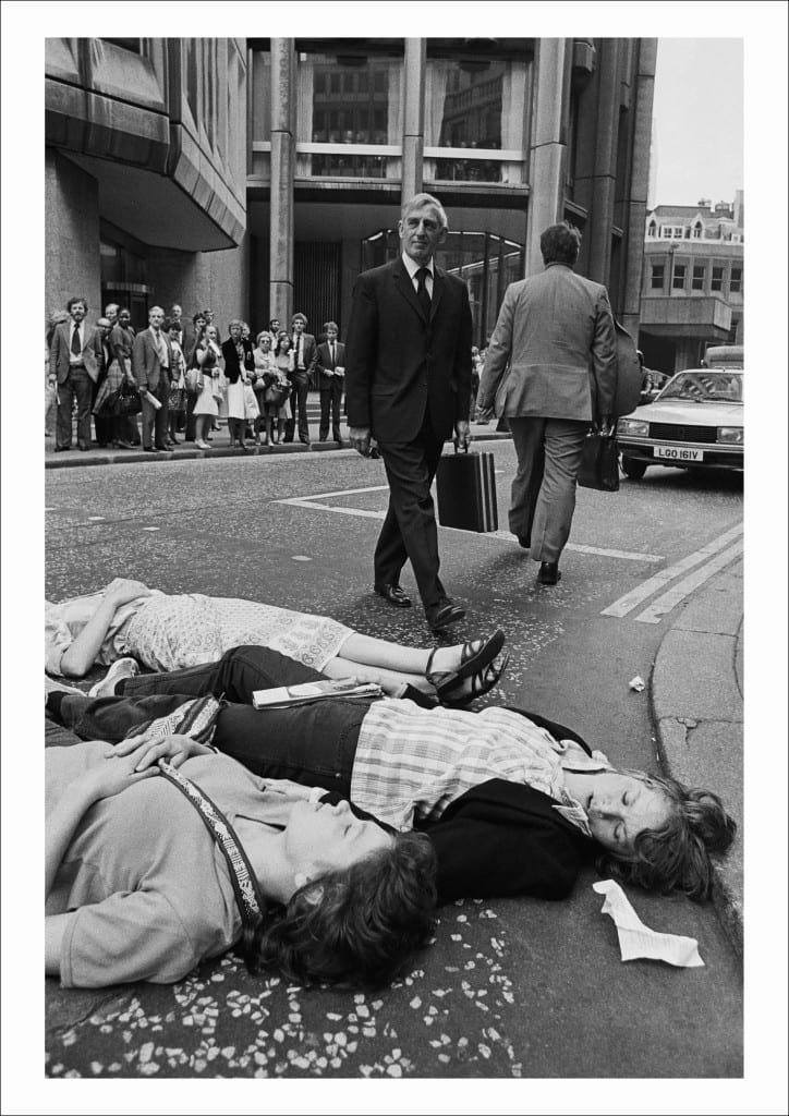 Greenham Common protesters stage a Die-in outside the Stock Exchange during the morning rush hour as U.S. President Reagan arrives in Britain, City of London (1982)