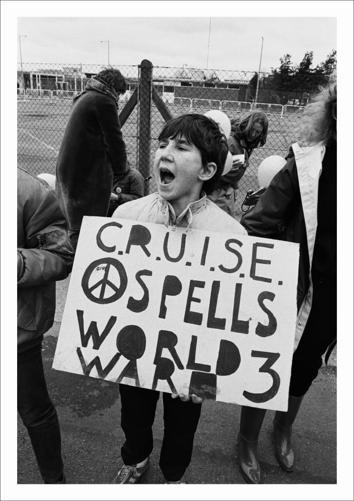 A young protester joins a CND rally after the 'Peace Chain' event staged outside the Atomic Weapons Research Establishment, Aldermaston, Berkshire (1983)