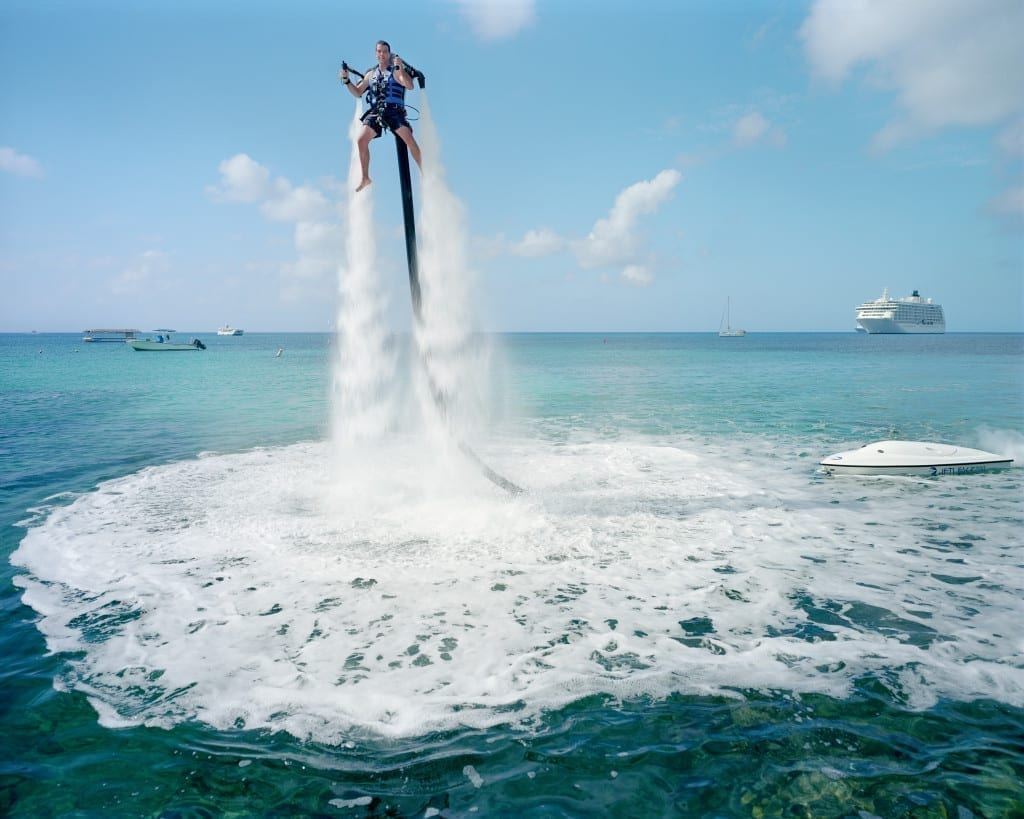 An employee of Jetpack Cayman demonstrates this new watersport, now available on the island, Grand Cayman.