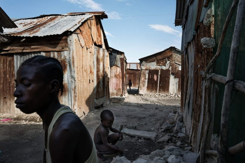 Haiti, Port-au-Prince, Cité Soleil. 2015. The densely populated and violent Cité Soleil controlled by gangs is considered to be the most dangerous place of the western world. Absence of economic activity puts its residents below the already low poverty level of Haiti. Cité Soleil has a population of around 400,000 inabitants. Climate change and deforestation dramatically reduced the farmland in the Haitian countryside and led to emigrate into urban areas the environmental migrants with the consequently development of slums area such as Citè Soleil which is considered to be the poorest and most densely populated area in Haiti.
