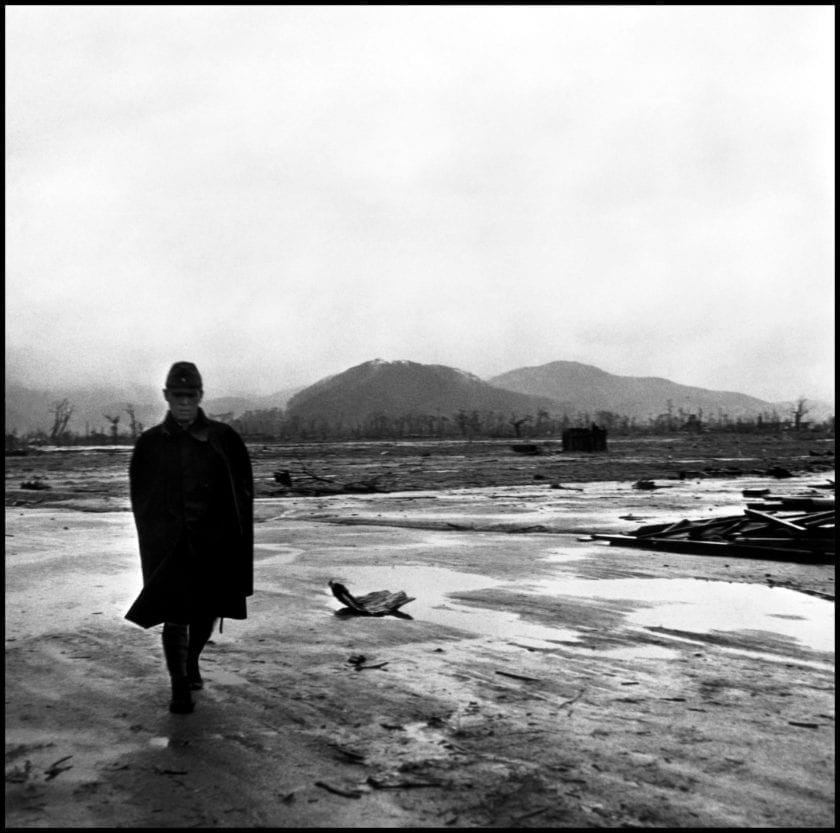 JAPAN. Hiroshima. September 8, 1945. Center of atomic bomb blast. Japanese soldier walks through site where army barracks once stood in the center of town.