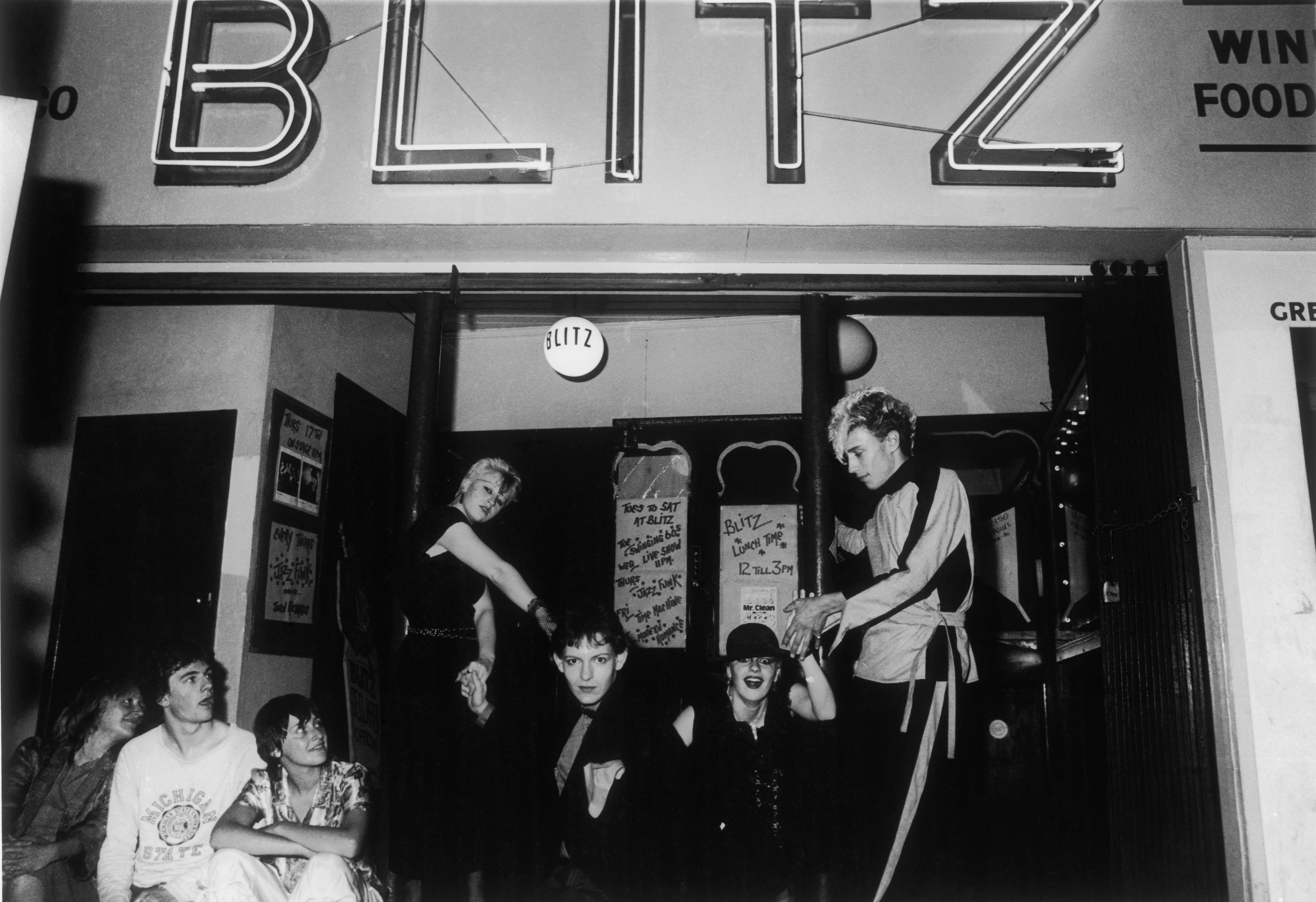A group of young people dressed in 'New Romantic' fashion on the steps of the Blitz nightclub in Covent Garden, c.1980. The Blitz club is widely regarded as being the birth place of the New Romantics in the early 1980s and those who frequented it were known as 'Blitz Kids'. One of these was Boy George.