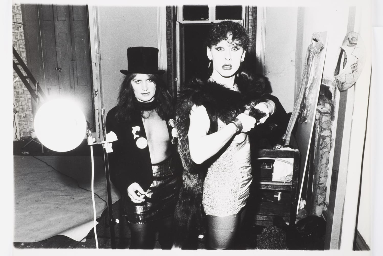Trans women, Pimlico, 1981. This image may be published free of charge if used to review or promote the exhibition 'Stomping Grounds: Photographs by Dick Scott-Stewart 27 May – 18 Sep 2016'. All uses must be credited © Dick Scott-Stewart Archive/Museum of London. Images may not be cropped or overlaid with text without permission. Images published on the web are limited to a maximum size of 600 pixels high. Uploading to social media channels is not permitted. All other uses must be cleared with the Museum of London and the copyright holder.