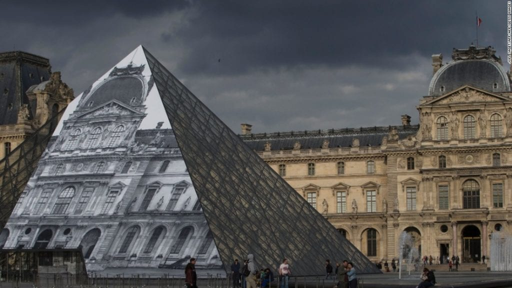 JR Makes The Louvre Invisible