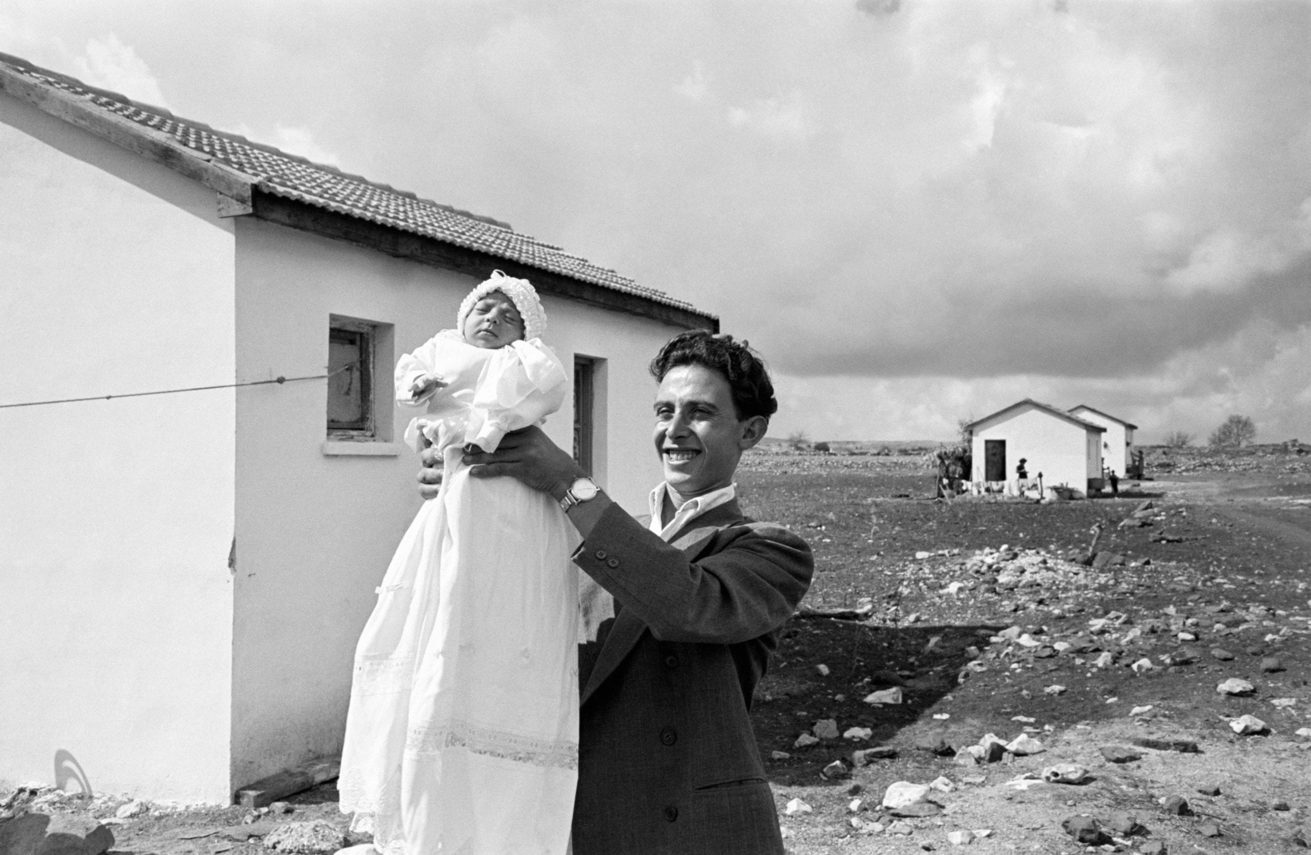 ISRAEL. 1951. First child (Miriam TRITO) born in the settlement of Alma. Eliezer TRITO is in charge of the pipeline construction work which is going to bring water from a source 3 miles away. He is seen here with the daughter he had with his wife Miriam.