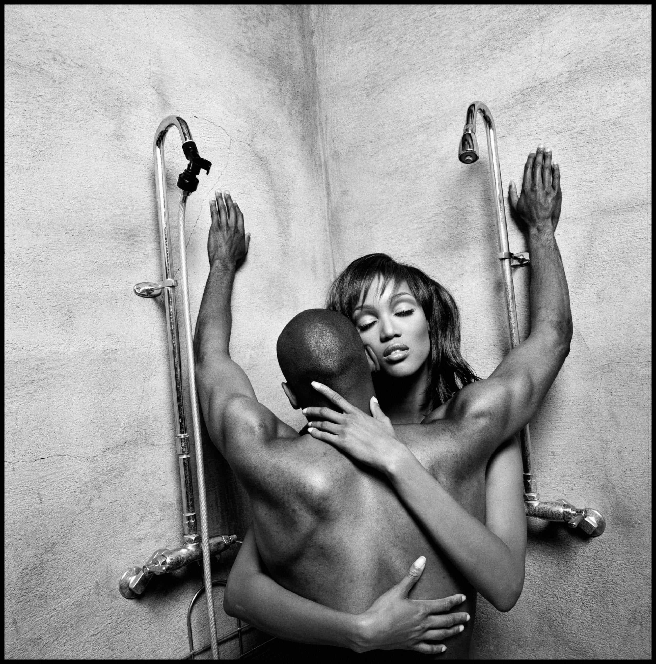 Model and actress Tyra Banks embraces film director John Singleton, 1994.