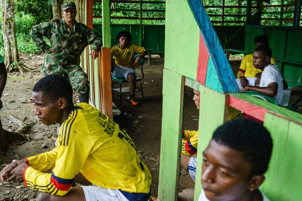 FARC rebels rest during the football match. 3 May 2016. Photo © Federico Rios