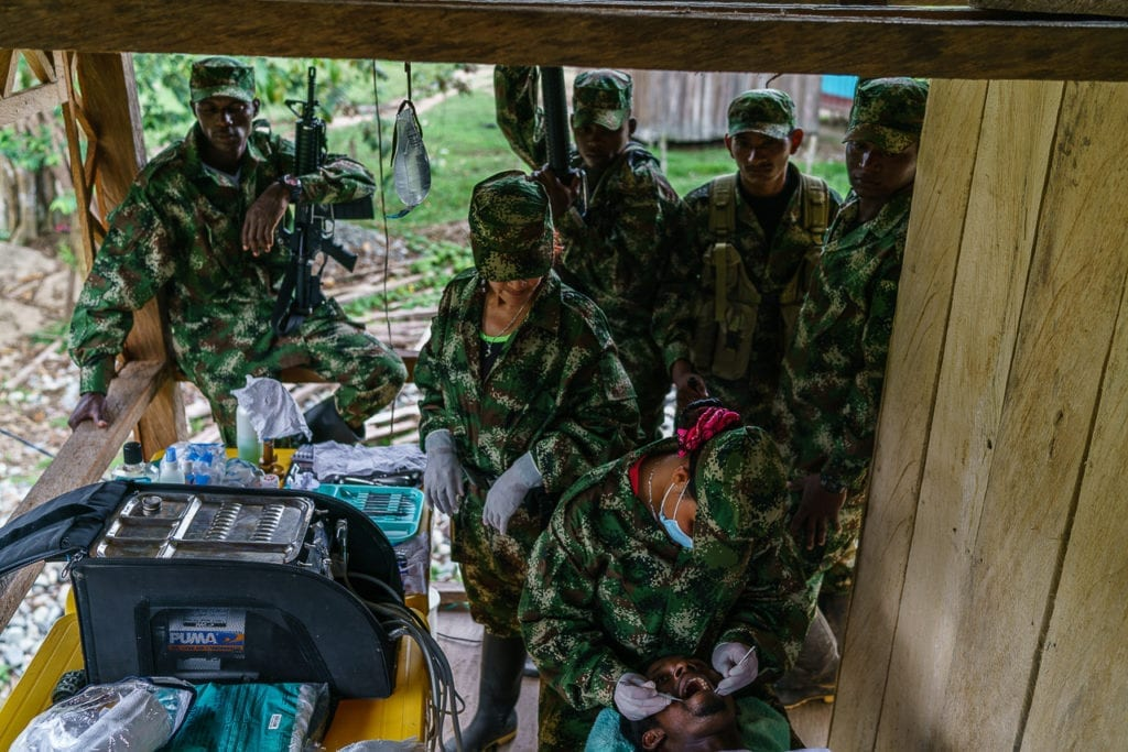 A patient gets treated at the FARC dentist. More or less 400 patients have been treated here in the past three months. Service is free of charge for the population in the area and many travel several days to reach the place. 2 May 2016. Photo © Federico Rios.