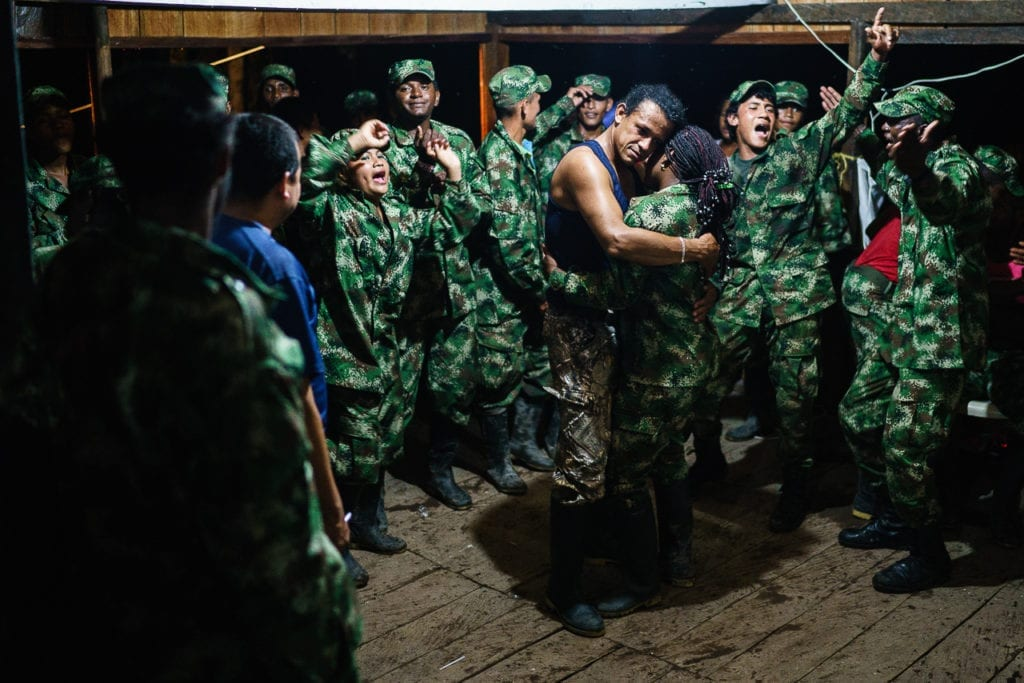 A group of FARC rebels dance and celebrate the front leader's birthday. 3 May 2016. Photo © Federico Rios